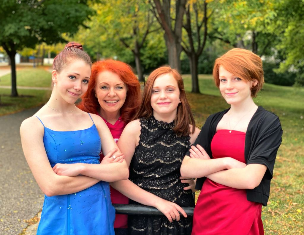 The Ginger Optimist with her three granddaughters